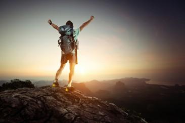 hiking-hiker-standing-mountain-top-1024x682